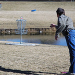 Mike Livingston putts against the pond on #11 at Expo Park.