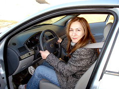 A photo of me clutching the steering wheel of a car.