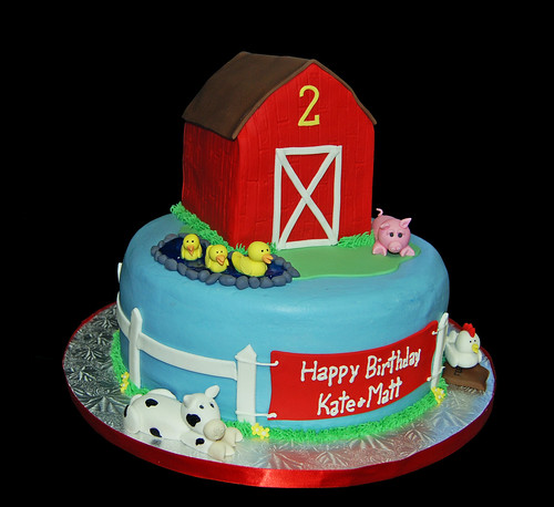 farm animal themed 2nd birthday cake with red barn ducks pig cow and a rooster