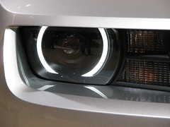 wheel(0.0), rim(0.0), automobile(1.0), automotive exterior(1.0), vehicle(1.0), automotive lighting(1.0), multimedia(1.0), light(1.0), grille(1.0), bumper(1.0), headlamp(1.0),
