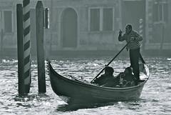 skiff(0.0), longship(0.0), viking ships(0.0), vehicle(1.0), watercraft rowing(1.0), boating(1.0), monochrome photography(1.0), gondola(1.0), watercraft(1.0), monochrome(1.0), black-and-white(1.0), boat(1.0),