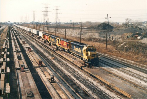 Eastbound Atchinson, Topeka & Santa Fe piggyback train approaching the South Pulaski Road overpass bridge. Chicago Illinois. November 1989. by Eddie from Chicago