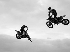 bicycle motocross(0.0), bmx bike(0.0), cycle sport(0.0), bmx racing(0.0), downhill(0.0), bicycle(0.0), racing(1.0), freestyle motocross(1.0), vehicle(1.0), sports(1.0), freeride(1.0), motorcycle(1.0), motorsport(1.0), motorcycle racing(1.0), monochrome photography(1.0), extreme sport(1.0), motorcycling(1.0), stunt performer(1.0), monochrome(1.0), black-and-white(1.0), stunt(1.0),