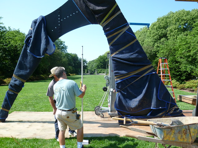 "The main component of the disassembled sculpture was aligned  within BBG's Osborn Garden. A plywood ""dancefloor"" protects the turf during the installation process. Photo by Elizabeth Peters."