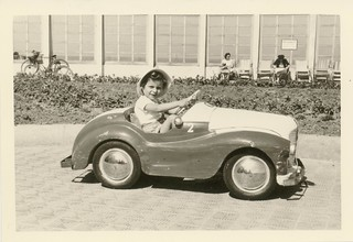 Unknown child in a toy car, Belgium (ca. 1959-1960)