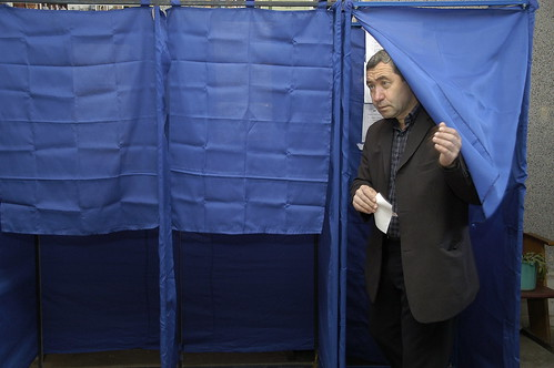 Georgian voter leaving a voting booth