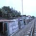 Perumahan tak bersertifikat. : Informal housing along the railway. Photo by Ardian