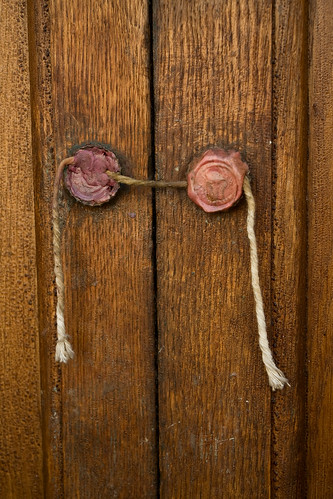 Two wax seals on a wooden door