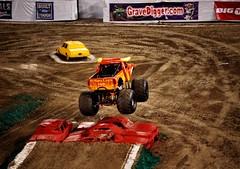 stock car racing(0.0), endurocross(0.0), sprint car racing(0.0), screenshot(0.0), auto racing(1.0), racing(1.0), sport venue(1.0), soil(1.0), vehicle(1.0), sports(1.0), race(1.0), dirt track racing(1.0), off road racing(1.0), motorsport(1.0), off-roading(1.0), monster truck(1.0), race track(1.0),