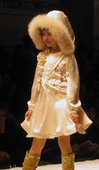 musical theatre(0.0), toy(0.0), fur(1.0), clothing(1.0), fur clothing(1.0), runway(1.0), fashion(1.0), fashion show(1.0), costume(1.0),