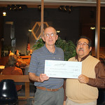 John Bird presenting check to Arvada Community Food Bank