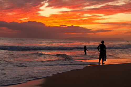 ocean travel light sunset red sea summer sky orange cloud west beach nature water beauty silhouette landscape island hawaii sand surf glow pacific dusk surfer board side wave scene surfing dude shore kauai hawaiian tropical swell vacations tranquil cloudscape afterglow kekaha