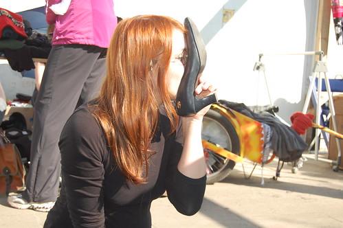 Manning sniffing old black pumps on fleamarket