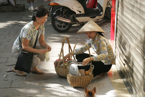 Buying eggs from a Hanoi street vendor