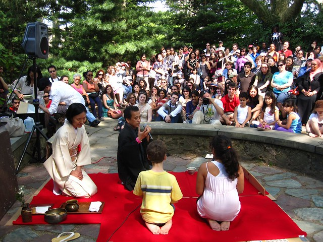 Two lucky visitors are chosen to learn and participate in a Japaneses tea ceremony during Sakura Matsuri 2010.