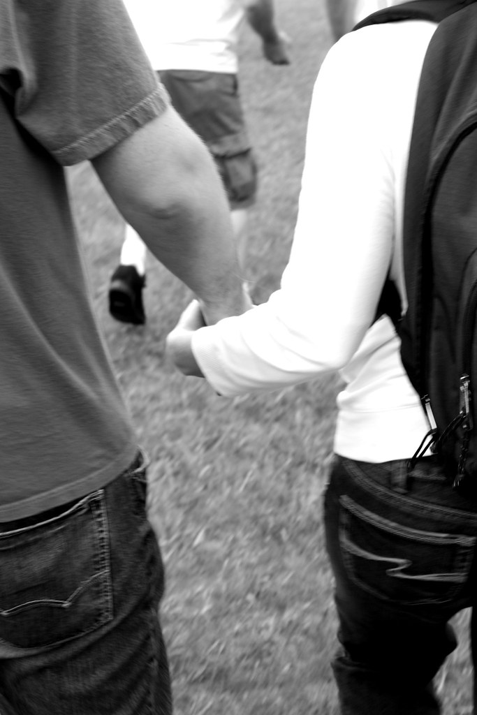 holding hands black and white photography