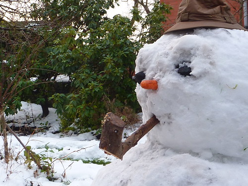 Snow man and his pipe