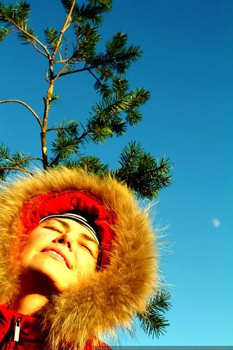 rachel, moon, sky, and her mom waving a pine twig overhead    MG 2508