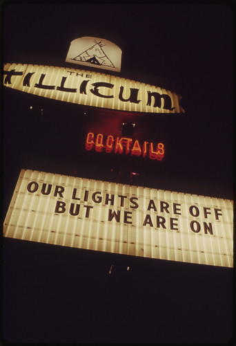 The Energy Crisis in the States Or Oregon and Washington Resulted in Attempts at Humor by Businesses with Outdoor Signboards. There Is Some Confusion on This One in Portland, Oregon It States Lights Are Off, But They Are on 11/1973