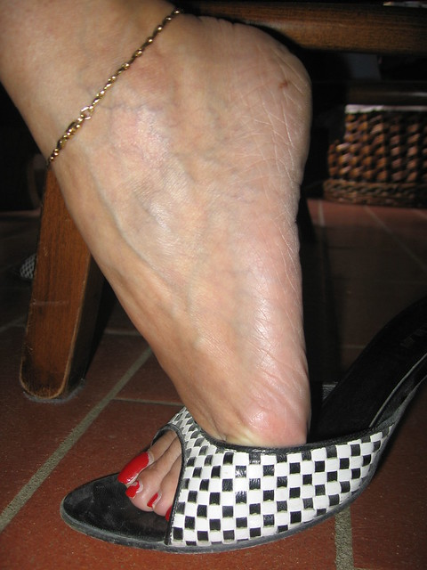 Sara Veiny Feet Under The Table A Photo On Flickriver