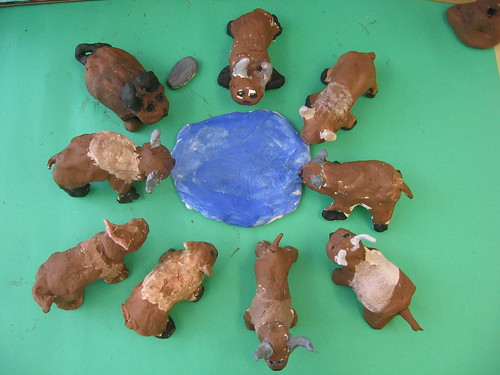 Clay Buddy Bison creations drinking from a watering hole