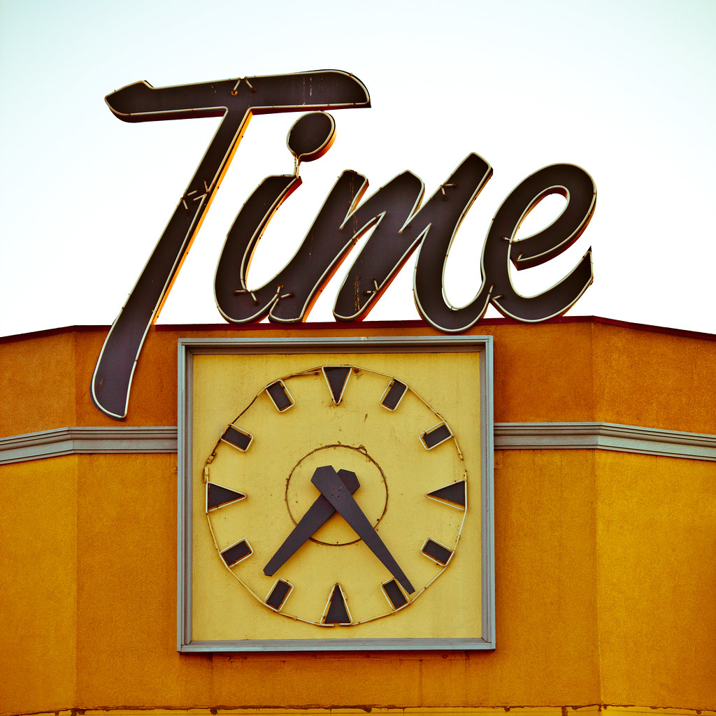 Sign and clock for Time Deli and Catering in San Jose, California
