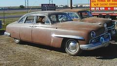 hudson hornet(0.0), pontiac chieftain(0.0), gaz-12 zim(0.0), compact car(0.0), luxury vehicle(0.0), automobile(1.0), automotive exterior(1.0), vehicle(1.0), full-size car(1.0), mid-size car(1.0), plymouth cranbrook(1.0), antique car(1.0), sedan(1.0), classic car(1.0), vintage car(1.0), land vehicle(1.0),