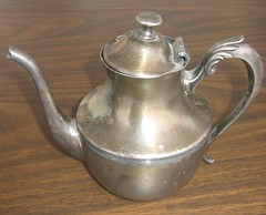stovetop kettle(0.0), jug(0.0), pitcher(0.0), drinkware(0.0), small appliance(0.0), metal(1.0), tableware(1.0), teapot(1.0),