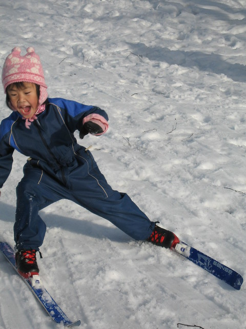 Oslo: A little girl laughing and enjoying skiing