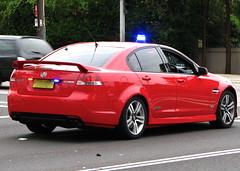 sports car(0.0), automobile(1.0), automotive exterior(1.0), executive car(1.0), wheel(1.0), vehicle(1.0), automotive design(1.0), rim(1.0), full-size car(1.0), compact car(1.0), bumper(1.0), pontiac g8(1.0), sedan(1.0), land vehicle(1.0), luxury vehicle(1.0),