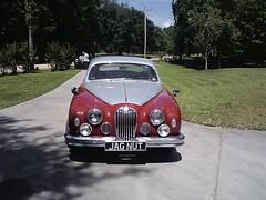 executive car(0.0), jaguar mark 2(0.0), jaguar xk150(0.0), convertible(0.0), supercar(0.0), sports car(0.0), automobile(1.0), automotive exterior(1.0), vehicle(1.0), automotive design(1.0), mitsuoka viewt(1.0), antique car(1.0), vintage car(1.0), land vehicle(1.0), luxury vehicle(1.0), jaguar s-type(1.0),