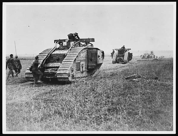 Tanks passing dead Germans who were alive before the cavalry advanced a few minutes before the picture was taken from Flickr via Wylio