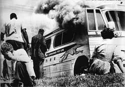 White racists bombed the Greyhound bus with freedom riders aboard in Anniston, Alabama on Mother's Day, May 14, 1961. The riders were protesting to abolish legalized segregation in interstate bus travel. by Pan-African News Wire File Photos