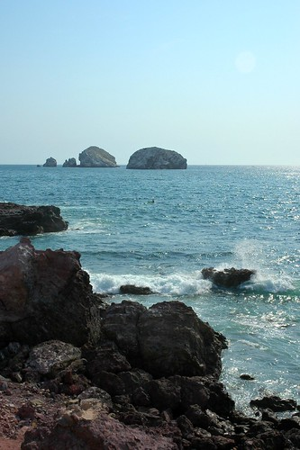 Lone kayaker, Pacific Ocean, rocks, Islands, South Mazatlan, Sinaloa, Mexico by Wonderlane