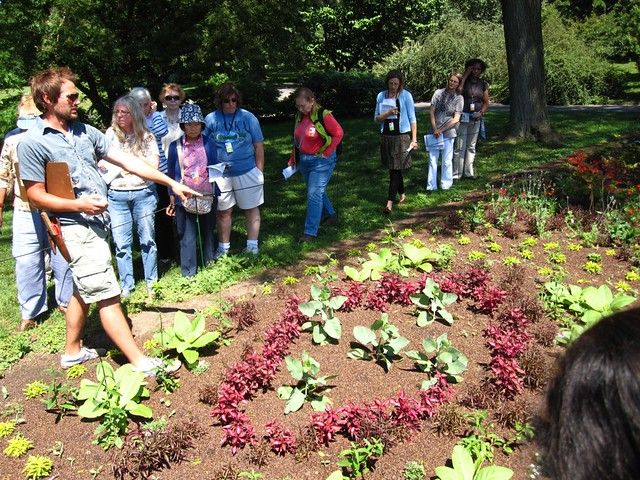 Curator Cayleb Long points out plants and designs of interest to BBG Garden Guides who will in turn inform visitors on tours.
