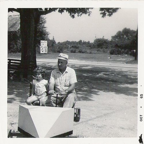 "Laurie and T.C. Parham Jr. on the ""go-cart"""