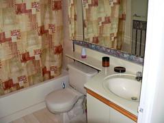 Full bathroom with tub & showe