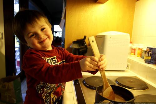 """""""i'm a good helper""""   making hot chocolate"""