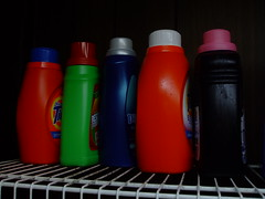 drinkware(0.0), tableware(0.0), red(1.0), bottle(1.0), plastic bottle(1.0),
