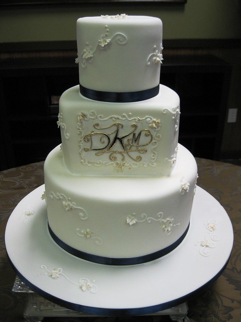 Navy and gold monogram wedding cake wwwstephaniethebakercom