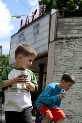 brothers drinking root beer outside the movie theater