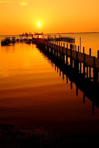 travel sunset orange usa sun yellow sunrise canon reflections landscape dock nikon fuji sebastian florida picture fl pilings indianriver indianrivercounty perfectsunsetssunrisesandskys mikewoodfin