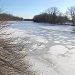 Charles River, 23 December 2009: Patches of snow on the frozen river under a cloud-free sky