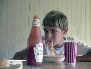 My friend eating spaghetti with ketchup. Milford Connecticut. August 1973