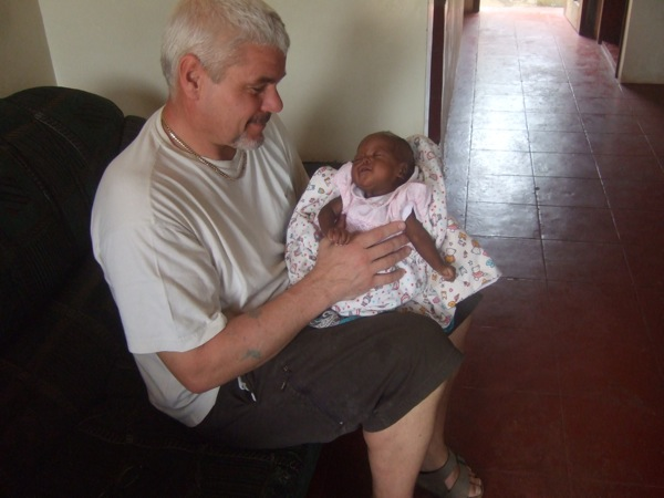 Kevin with our latest addition Baby Michelle