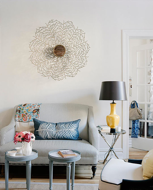 Ideas for small spaces: Loveseat + pops of yellow + decorative mirror