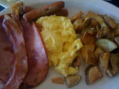 steak(0.0), vegetarian food(0.0), steak frites(0.0), produce(0.0), french fries(0.0), meal(1.0), breakfast(1.0), junk food(1.0), meat(1.0), food(1.0), full breakfast(1.0), potato wedges(1.0), dish(1.0), cuisine(1.0), bratwurst(1.0),