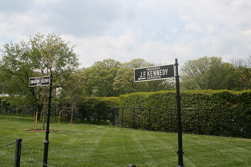 Signs pointing to the graves of the Kennedys and Unknown soldiers