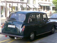 compact car(0.0), automobile(1.0), vehicle(1.0), austin fx4(1.0), mid-size car(1.0), subcompact car(1.0), antique car(1.0), sedan(1.0), land vehicle(1.0),