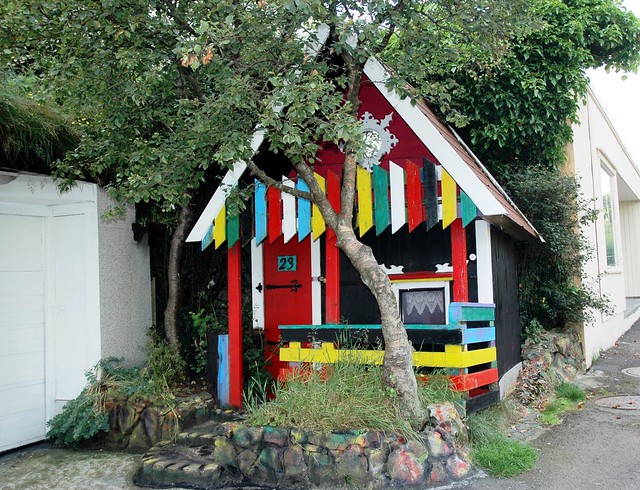 Brightly coloured housefront at the entrance to Vidarlundin park in Torshavn, Faroes